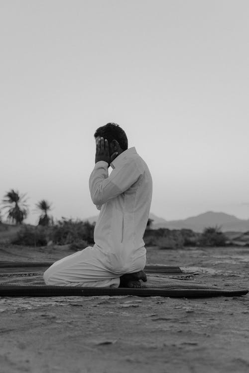 Monochrome Photo Of Man Praying