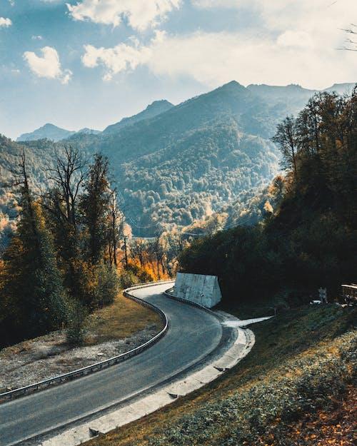 Narrow asphalt road in mountainous area