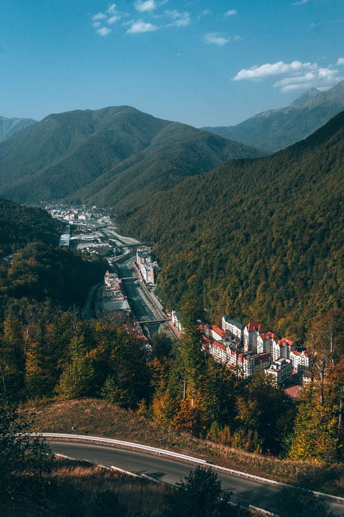 Settlement behind road in mountainous terrain