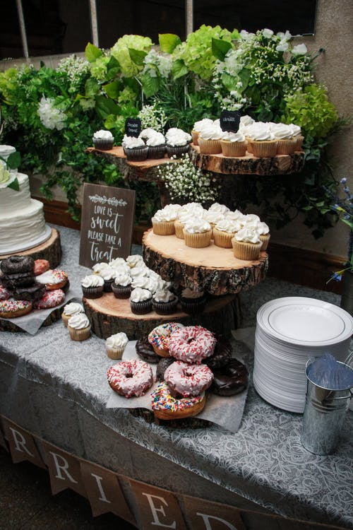 Delicious desserts on decorated wedding table