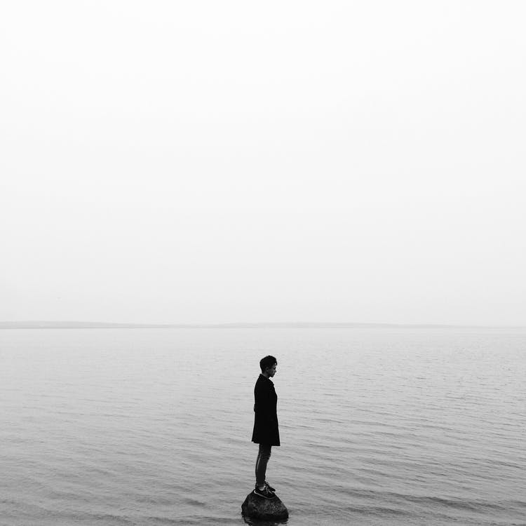 Man in Black Jacket Standing on the Seashore