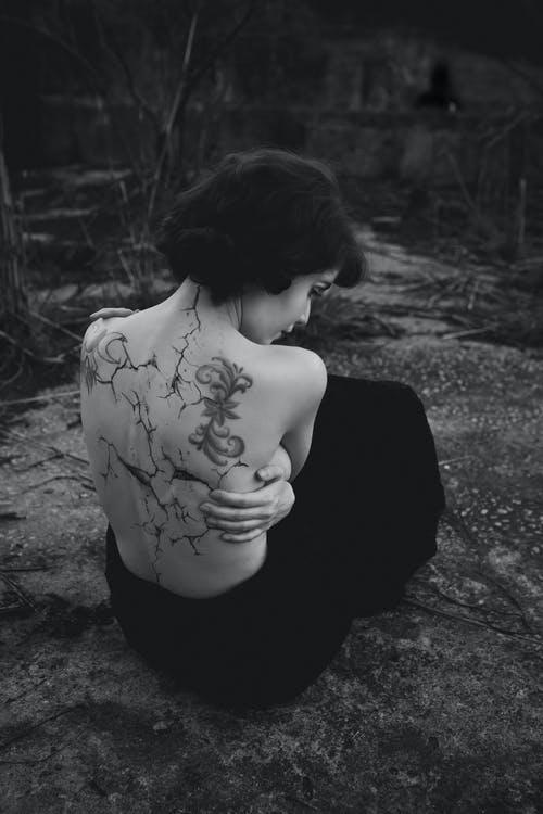 Grayscale Photo of Woman With Tattoo on Her Back