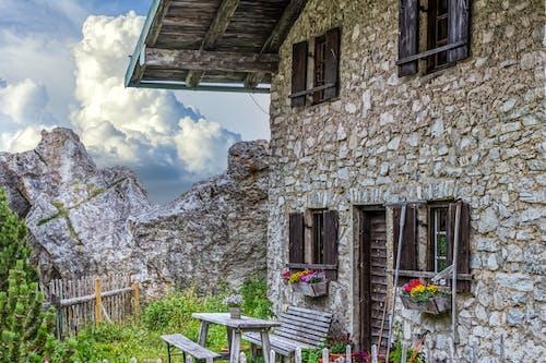 Free stock photo of alps, brick house, mountain