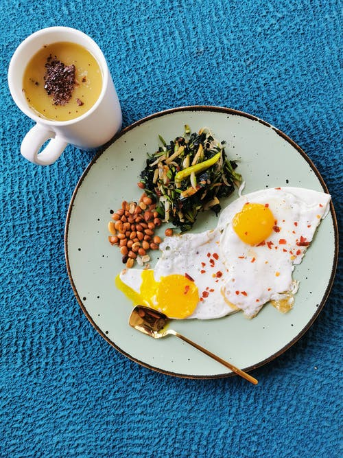 Egg and Vegetable Dish on Blue Ceramic Plate