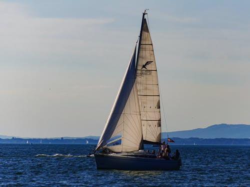 White and Black Sail Boat on Sea