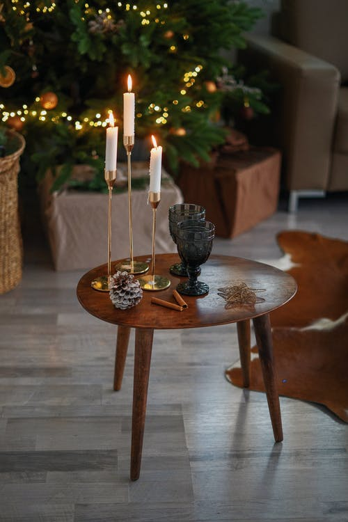 White Candles on Brown Wooden Round Table