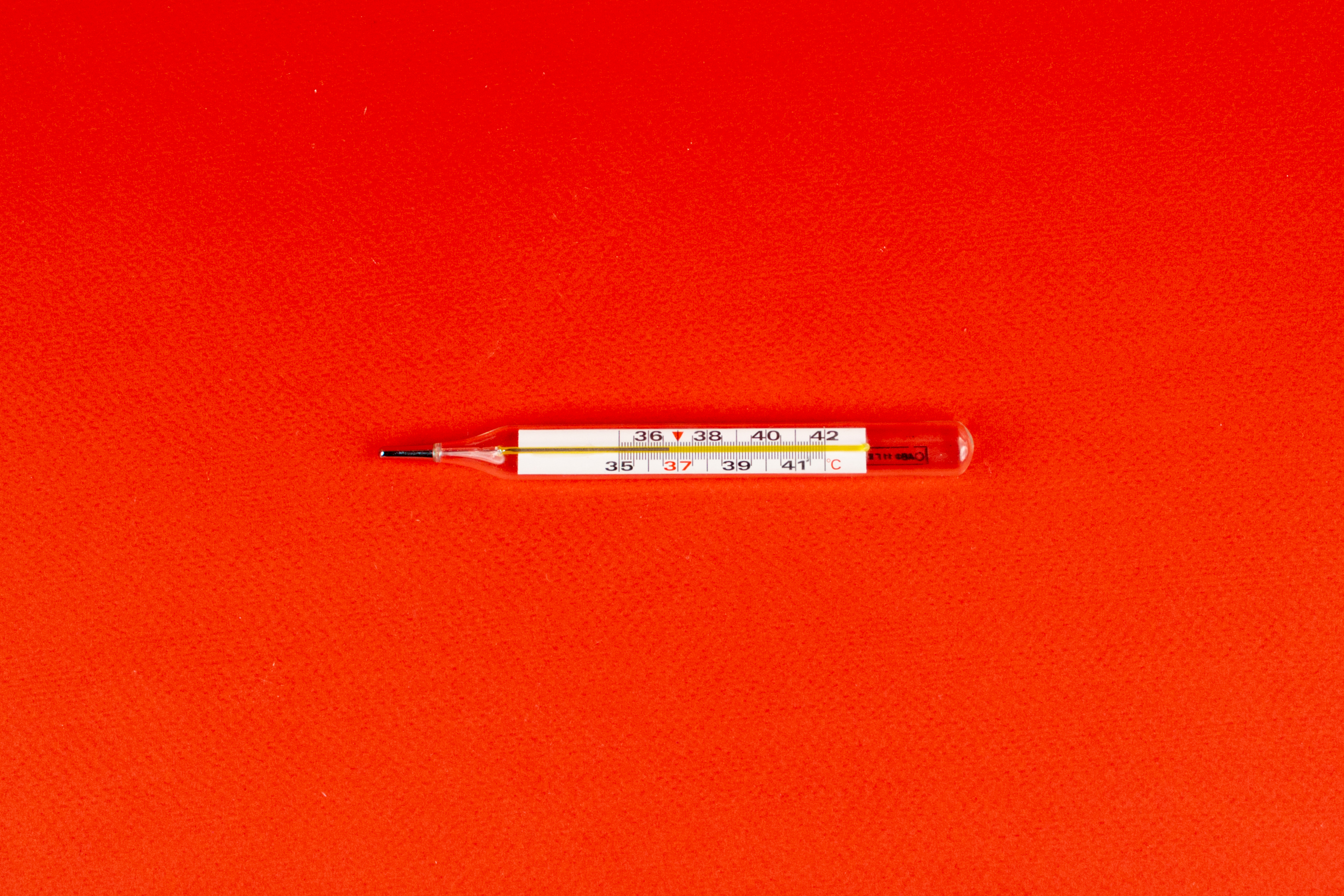 red and white click pen