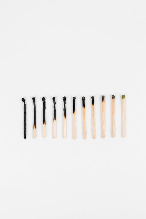 White and Brown Sticks on White Background