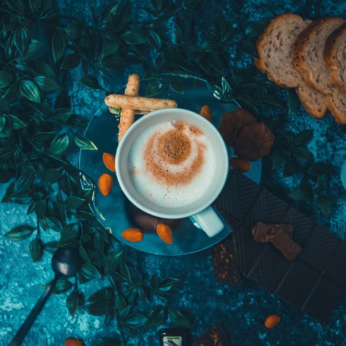 Cup of coffee with desserts on table