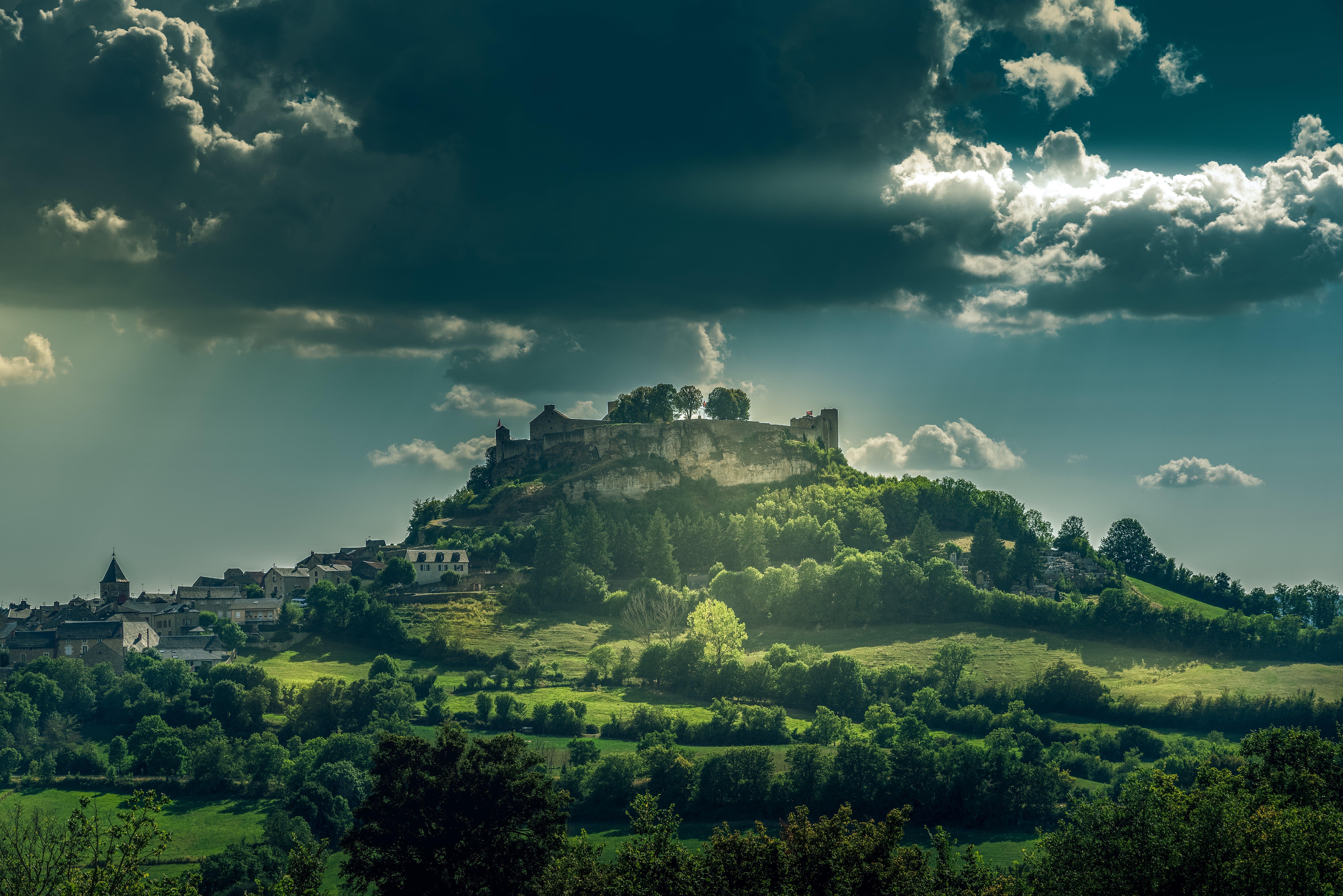 Green Valley Under Gray Sky