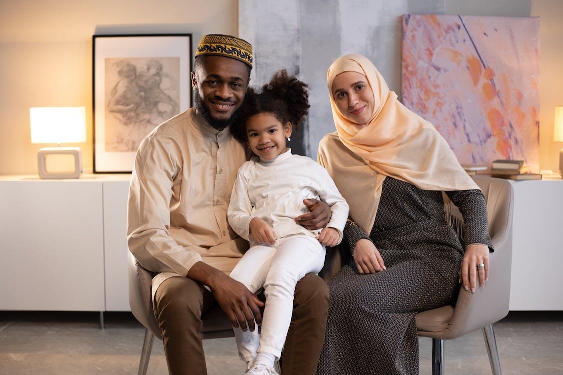 Happy black family in light room