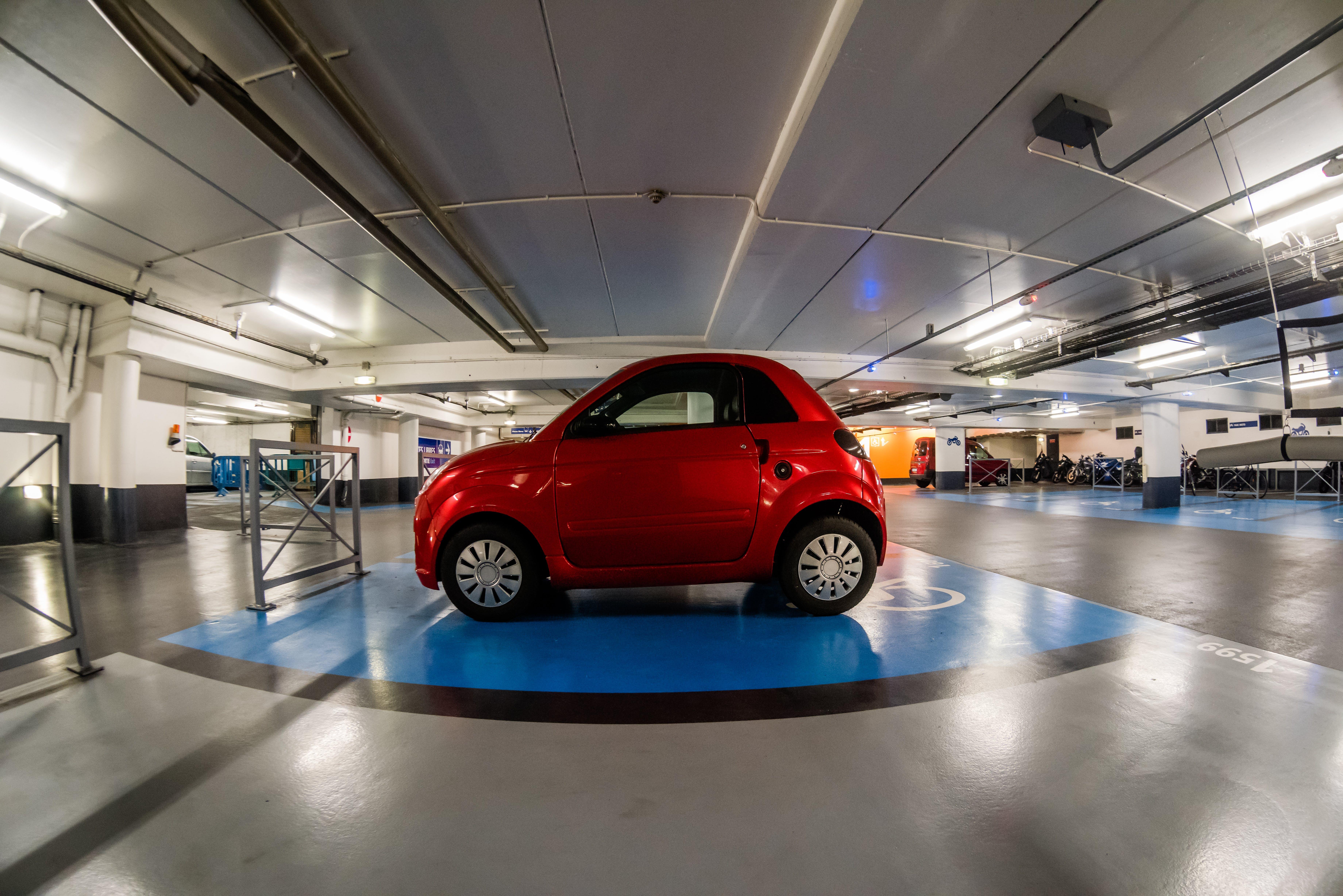Free stock photo of fisheye, parking, parking slot, red car