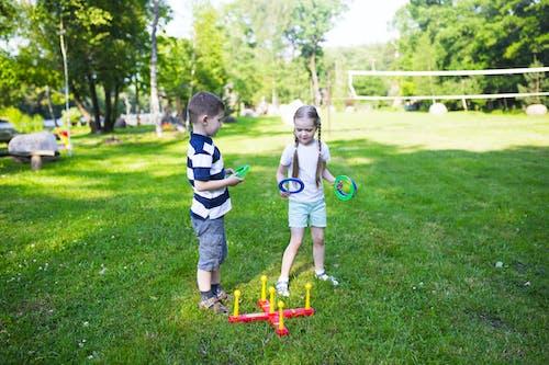2 Boys Playing on Green Grass Field