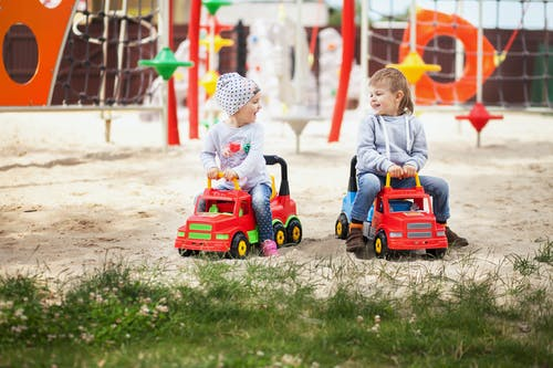 Child Riding Red Ride on Toy Car
