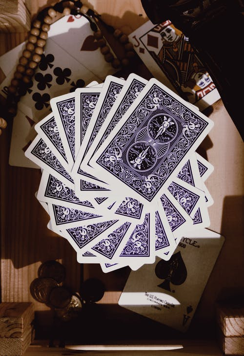 Playing Cards on Wooden Table