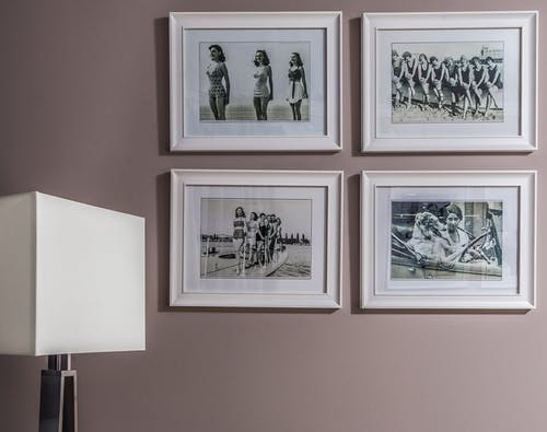 Collection of framed photos on wall