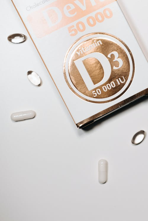 Vitamin Capsules Beside White Labeled Box