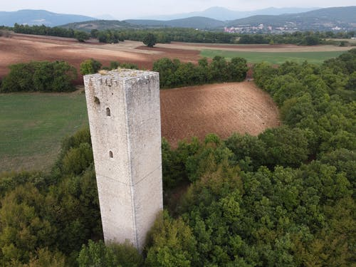 Drone view medieval tower located on verdant valley