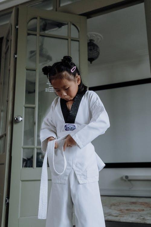 A Girl Wearing a White Karategi