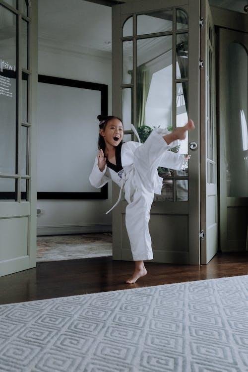 A Girl in Karategi Practicing Her Martial Arts