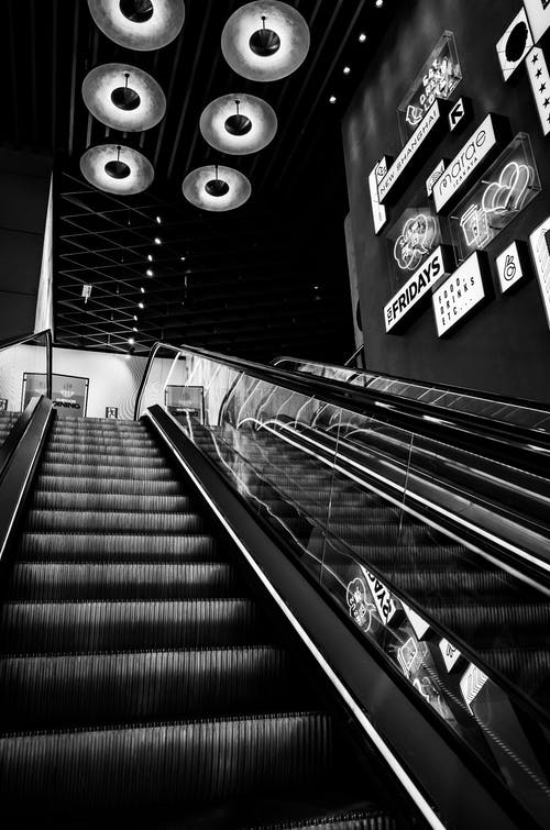 Grayscale Photo of an Escalator