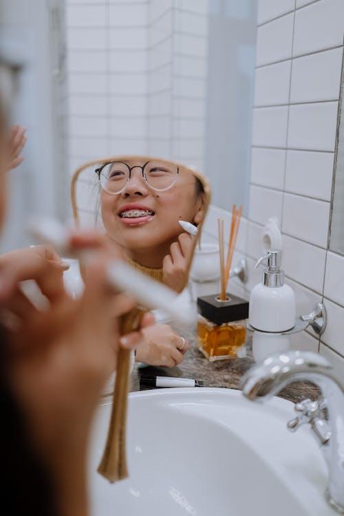Woman in Black Framed Eyeglasses Holding Cigarette Stick