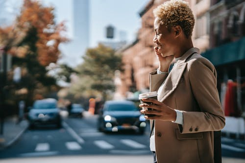 Happy black businesswoman having phone call