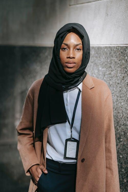 Black woman in hijab looking at camera