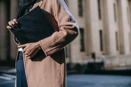 Person in Brown Coat Standing on Sidewalk
