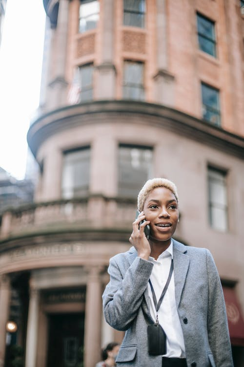 Glad black businesswoman speaking on phone