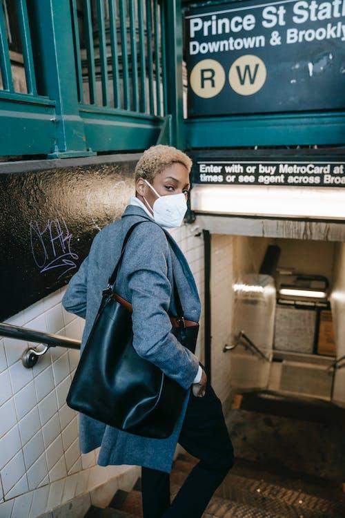 Man in Blue Denim Jacket Wearing White Face Mask