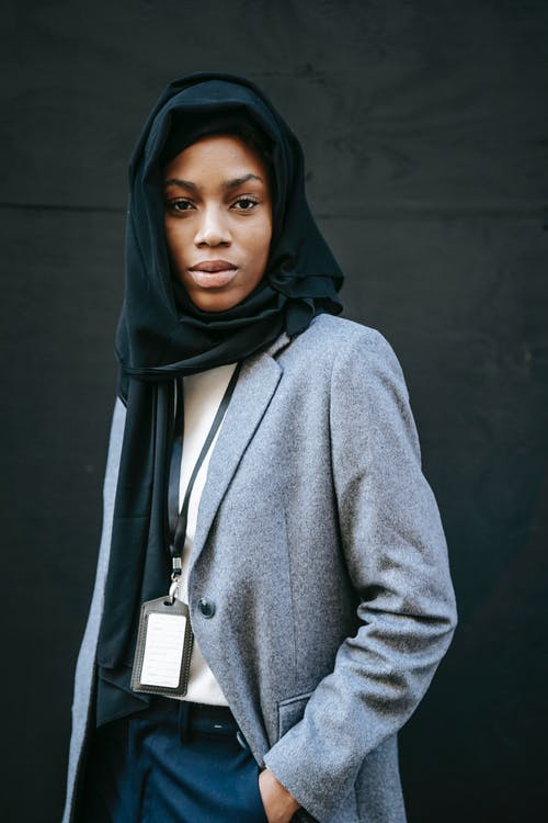 Woman in Gray Coat and Black Hijab