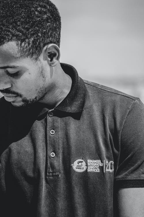 Thoughtful black man in T shirt