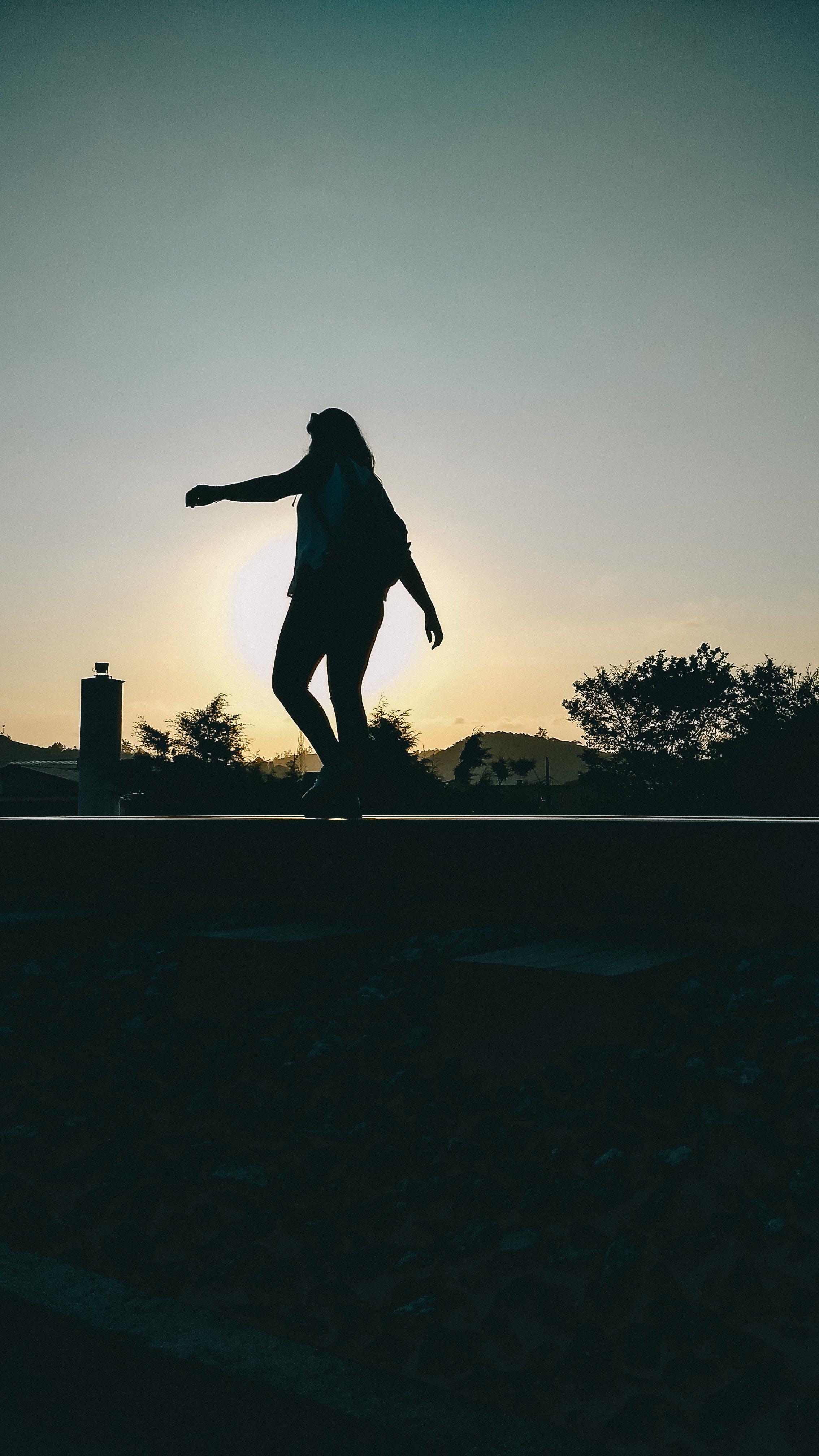 Free stock photo of girl, sunset, train, walking