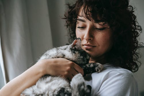 Charming woman with adorable fluffy cat
