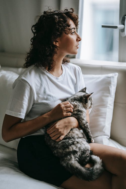 Woman with cat looking away