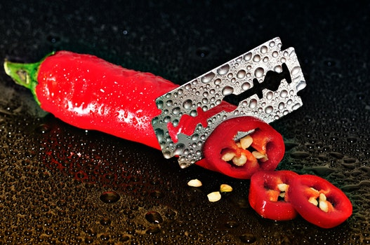 Red Chili Pepper Sliced by a Blade