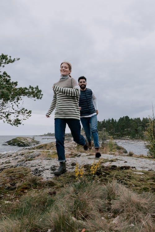 2 Women Standing on Seashore