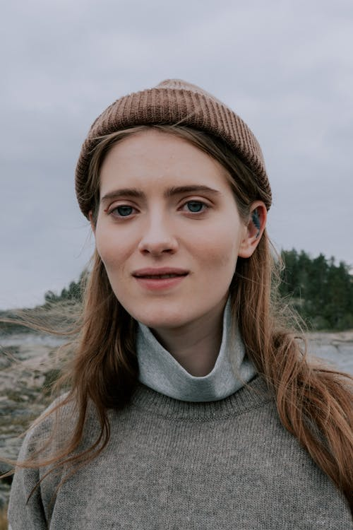 Woman in Gray Turtleneck Shirt and Brown Knit Cap