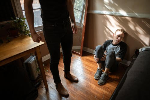 Boy in Gray Sneakers Sitting on the Floor