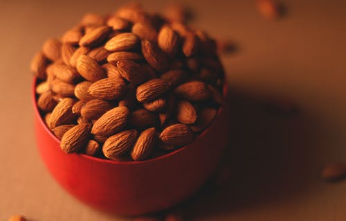 Almonds in Red Bowl