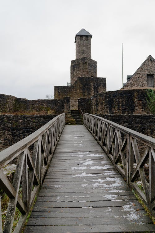 Medieval castle located near bridge in countryside