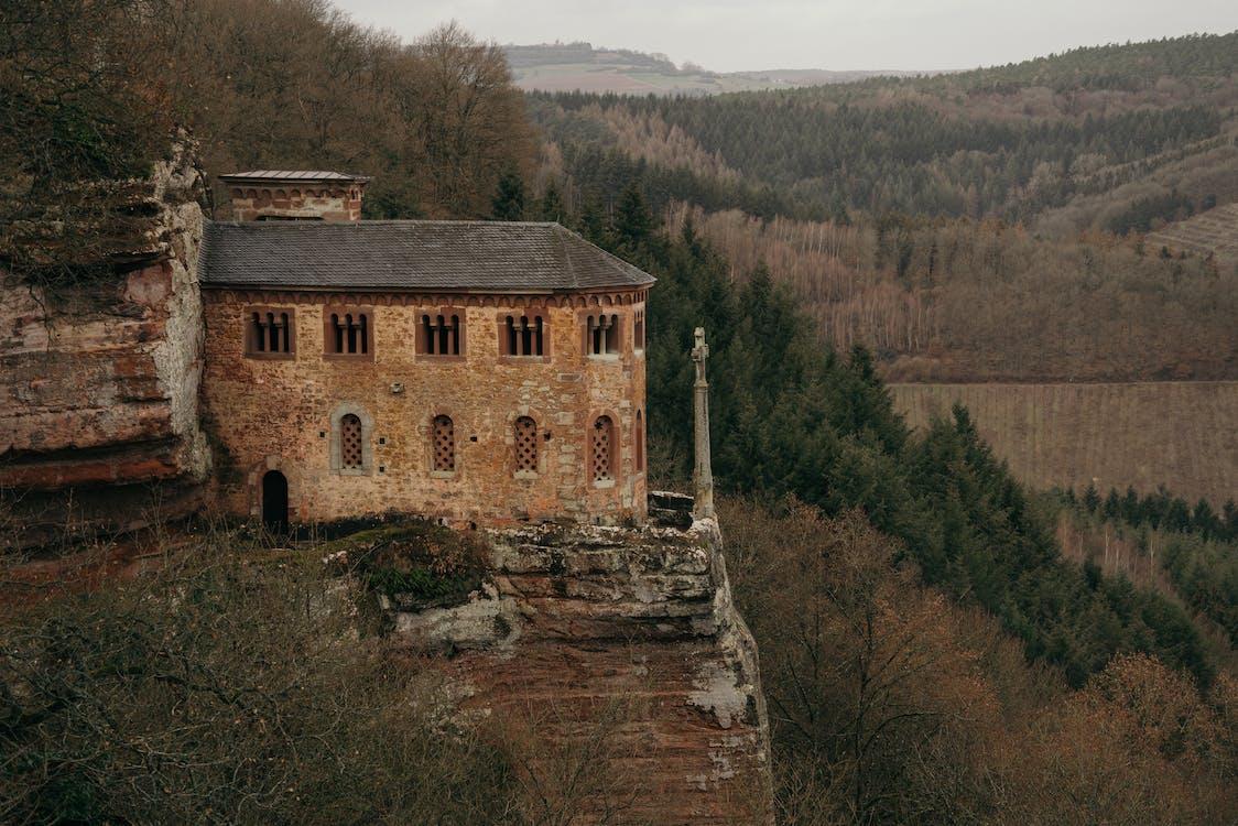 Medieval castle on mountain in mountainous area