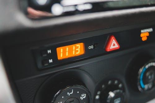 Electronic clock on dashboard of car