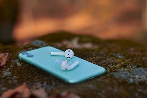 White Earbuds on Blue Iphone Case