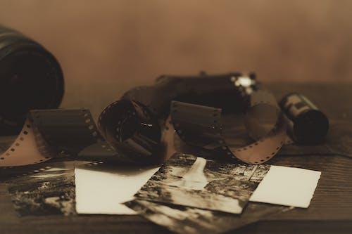 Black Dslr Camera on White Paper