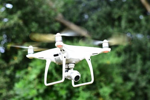 White Drone in Mid Air