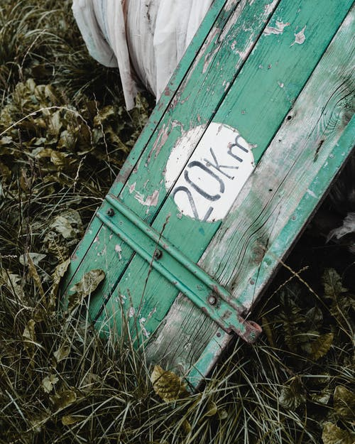 Green Wooden Bench With No Smoking Sign