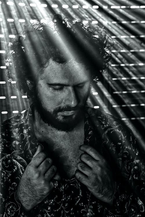 Free stock photo of attractive man, back light, beard