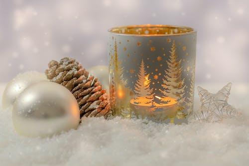 White and Brown Ceramic Mug on White Snow